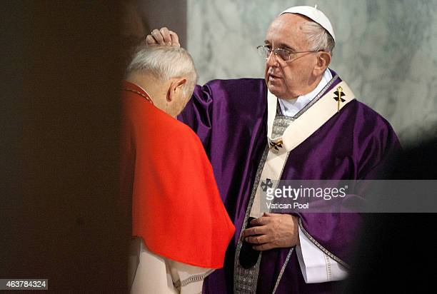 Pope Francis blesses with the ritual placing of ashes on the head of a cardinal during the Ash Wednesday service at the Santa Sabina Basilica on...
