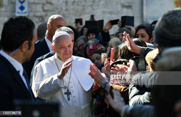 Pope Francis blesses worshipers and attendees during a visit to Bari, southern Italy, on February 23, 2020 to address a conference entitled...