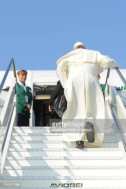 Pope Francis boards a plane on July 22 2013 at Rome's Fiumicino airport on his way to his first overseas trip to Brazil for World Youth Day CREDIT...
