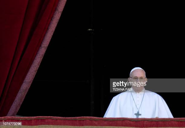 TOPSHOT Pope Francis celebrates from the balcony of St Peter's basilica during the traditional Urbi et Orbi Christmas message to the city and the...