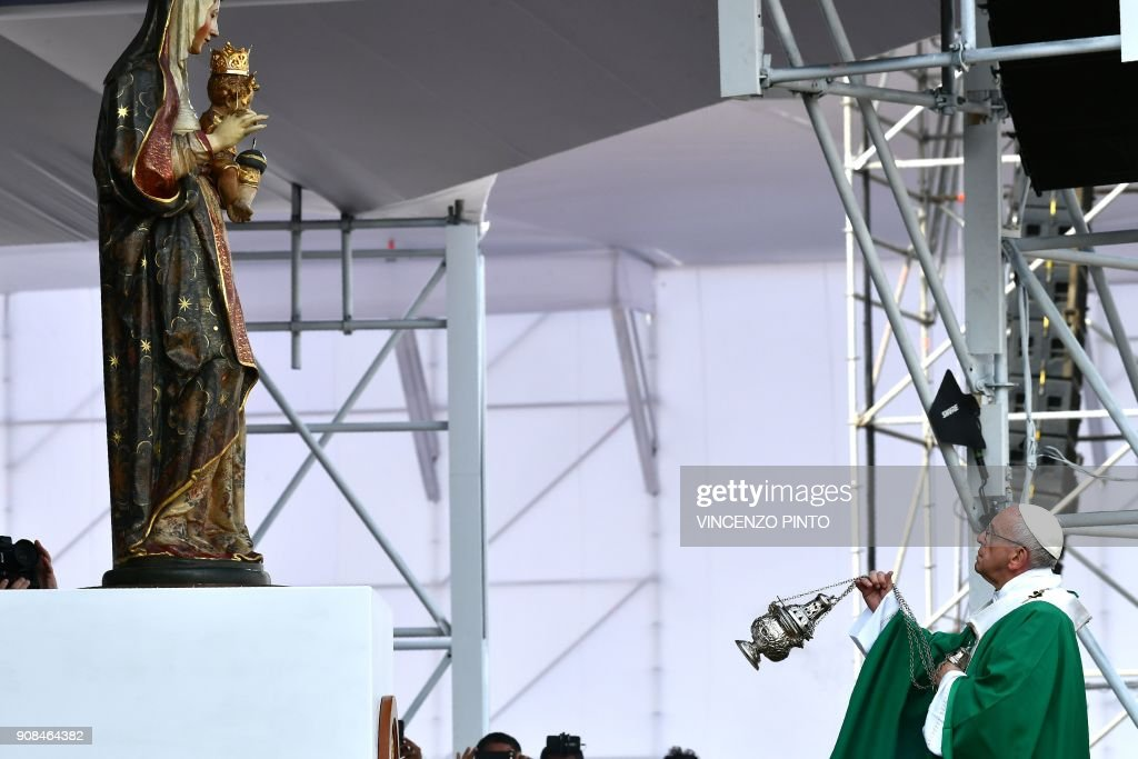Pope Francis celebrates mass at the Las Palmas air base in Lima on January 21, 2018. Pope Francis was preparing to wrap up his Latin American trip on Sunday with a mass at the air base where a million faithful were expected to hear him speak. On the last day of a week-long trip that has taken him to six cities in Chile and Peru, the 81-year-old pontiff began the day by delivering a homily to 500 nuns, as well as meeting the bishops of Peru. PHOTO / Vincenzo PINTO