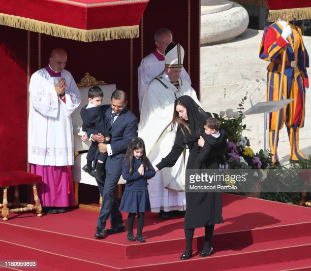 Pope Francis celebrates Mass in St Peter's Square with the canonization ceremony for five blessed In the photo Melissa Villalobo and her family...
