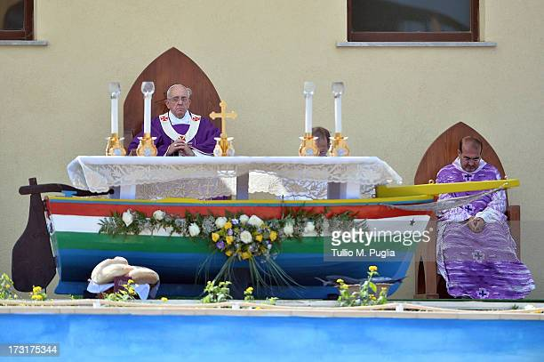 Pope Francis celebrates the Holy Mass as Father Stefano Nastasi Pastor of San Gerlando churc in Lampedusa looks on during his visit to the island on...
