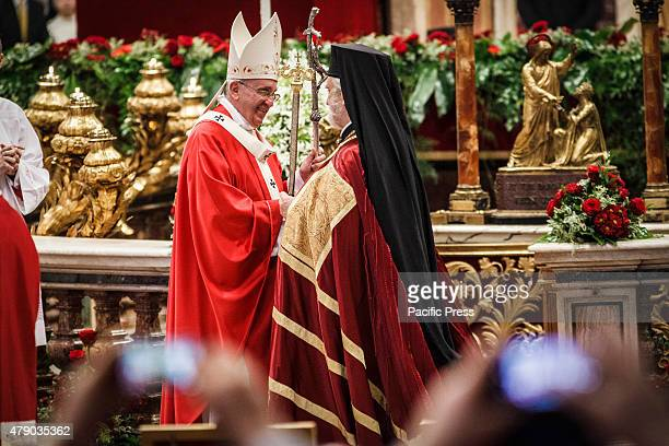 Pope Francis celebrates the Holy Mass with the imposition of the Pallium a woolen shawl symbolizing their bond to the Pope upon the new Metropolitan...