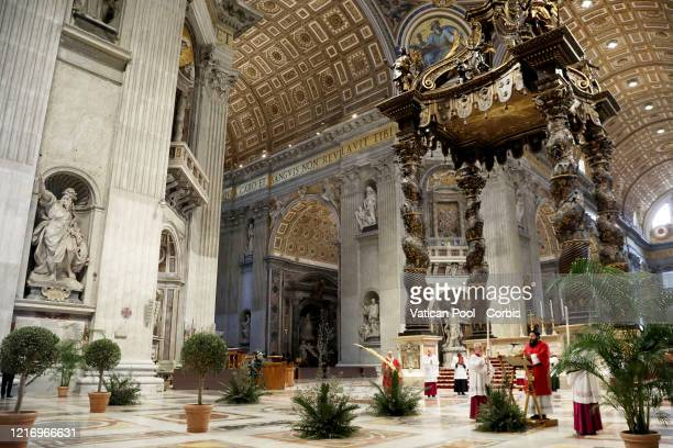 Pope Francis celebrates the Palm Sunday Mass behind closed doors inside St Peter's Basilica at the Vatican during the lockdown due to the spreading...