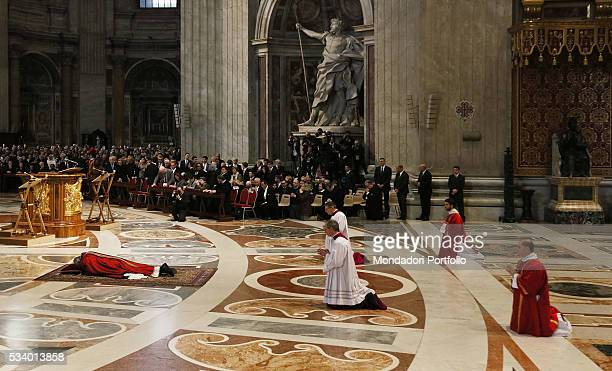 Pope Francis chairing the celebration of the Passion of Christ at Saint Peter's Basilica Once he reached the altar the Holy Father bows down on the...