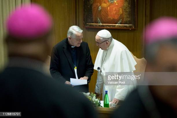 Pope Francis chats with his former spokesman father Riccardo Lombardi during a session of 'The Protection Of Minors In The Church' meeting at the...