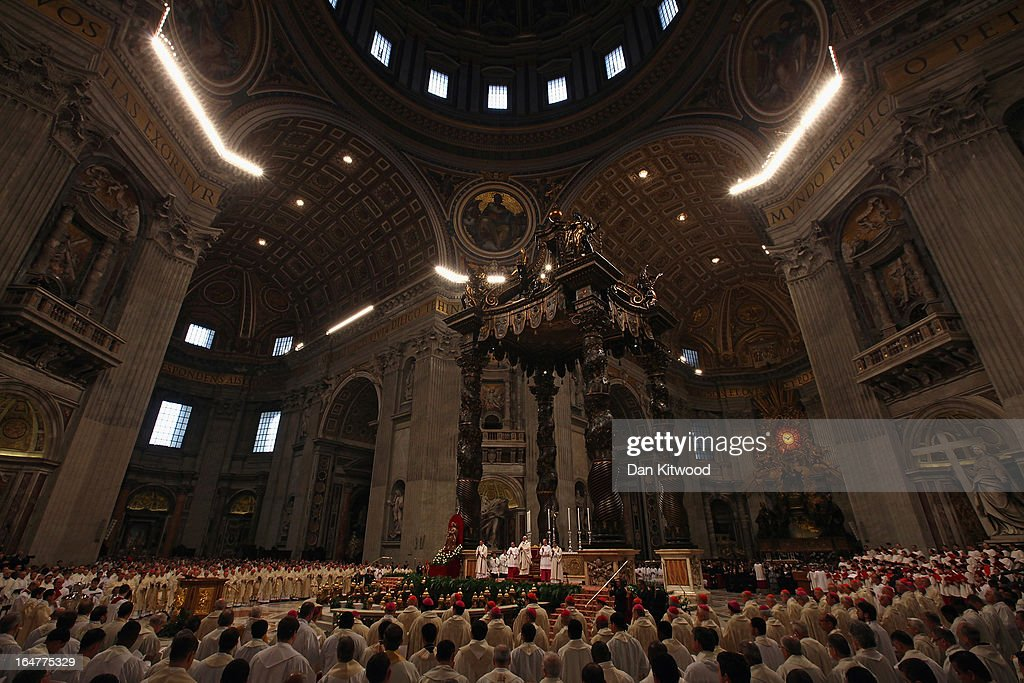 Pope Francis conducts his first Chrism Mass inside St Peter's Basilica on the morning of Holy Thursday on March 28, 2013 in Vatican City, Vatican. Newly-appointed Pope Francis has begun the Christian traditions leading up to Easter during his first holy week as pontiff. Pope Francis will today hold a feet-washing mass, which commemorates the last supper, at a youth detention centre where he will wash the feet of prisoners.