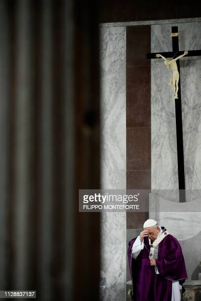 Pope Francis crosses himself during the Ash Wednesday mass which opens Lent the fortyday period of abstinence and deprivation for Christians before...
