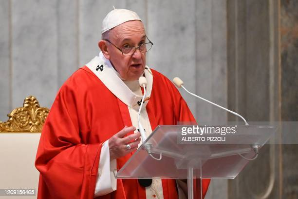 Pope Francis delivers a homily during Palm Sunday mass behind closed doors at St. Peter's Basilica mass on April 5, 2020 in The Vatican, during the...