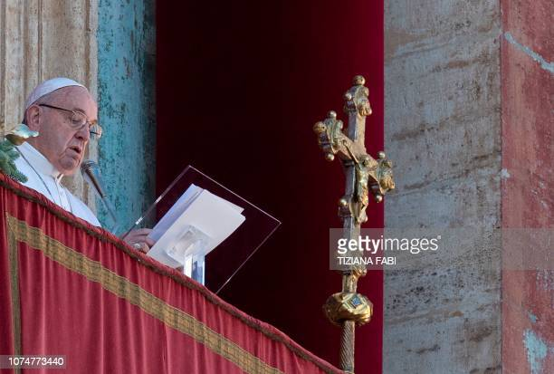 Pope Francis delivers a speech from the balcony of St Peter's basilica during the traditional Urbi et Orbi Christmas message to the city and the...