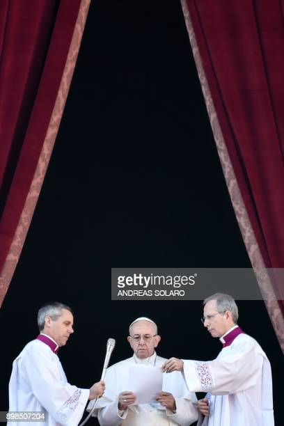 Pope Francis delivers a speech from the balcony of St Peter's basilica during the traditional 'Urbi et Orbi' Christmas address and blessing given to...