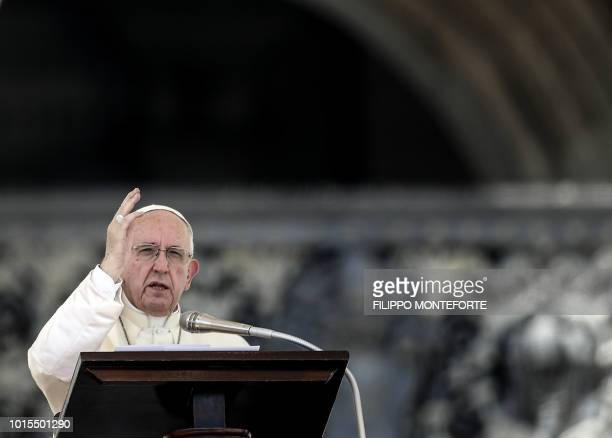 Pope Francis delivers his blessing during the Sunday Angelus prayer after a mass held by Cardinal Gualtiero Bassetti in St Peter's square at the...