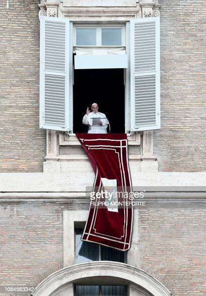 Pope Francis delivers his blessing from his studio window overlooking St Peter's Square at The Vatican on October 28 during the Sunday Angelus prayer