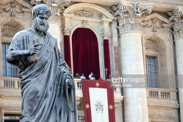 Pope Francis delivers his Christmas Urbi Et Orbi blessing from the central balcony of St Peter's Basilica on December 25 2017 in Vatican City Vatican