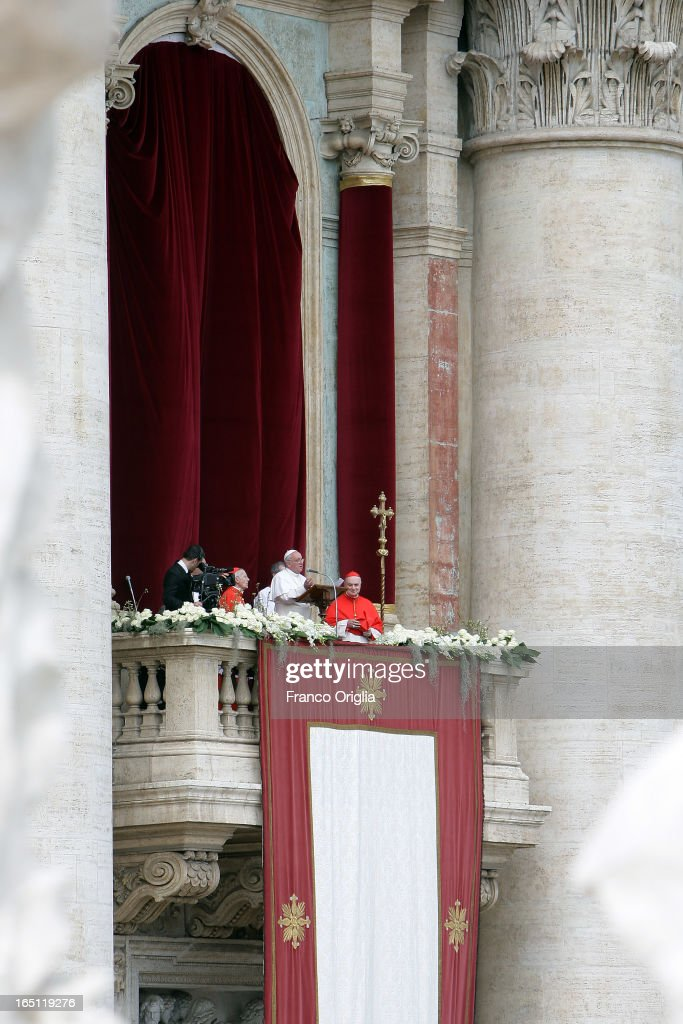 Pope Francis delivers his first 'Urbi et Orbi' blessing from the balcony of St. Peter's Basilica during Easter Mass on March 31, 2013 in Vatican City, Vatican. Pope Francis delivered his message to the gathered faithful from the central balcony of St. Peter's Basilica in St. Peter's Square after his first Holy week as Pontiff.