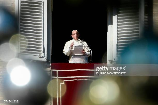 Pope Francis delivers his message during Angelus prayer on December 26 2018 from the window of the Apostolic palace overlooking St Peter's square at...