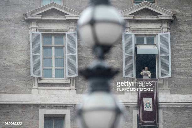 Pope Francis delivers his message during the weekly Angelus prayer on November 25 2018 as rains pours over St Peter's square in the Vatican