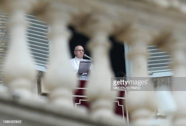Pope Francis delivers his message from the window of the Apostolic Palace overlooking St Peter's square in the Vatican during the weekly Angelus...