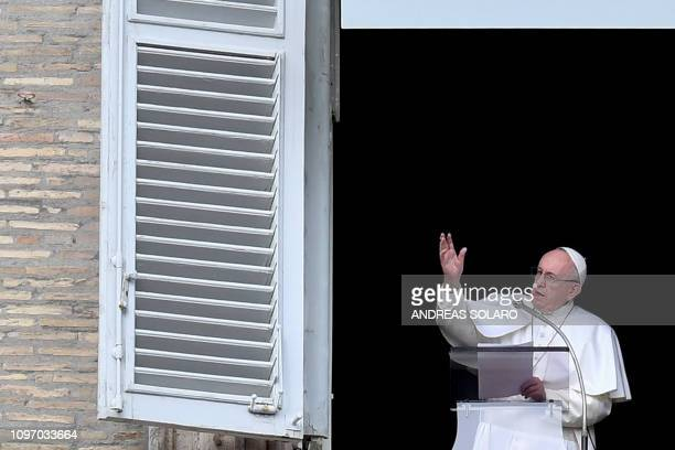 Pope Francis delivers his message from the window of the Apostolic Palace overlooking St Peter's square during the weekly Angelus prayer on February...