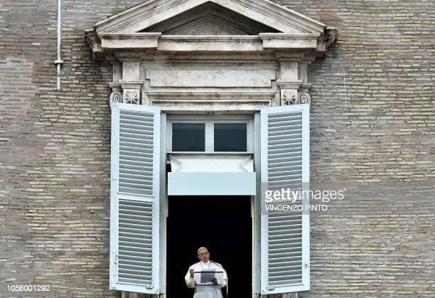 Pope Francis delivers his message to pilgrims gathered in St Peter's Square at The Vatican on November 1 during his Angelus prayer to mark the All...