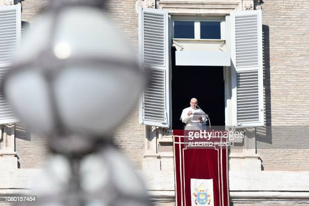 Pope Francis delivers his message to the faithful during the weekly Angelus prayer on November 11 2018 at St Peter's square in the Vatican