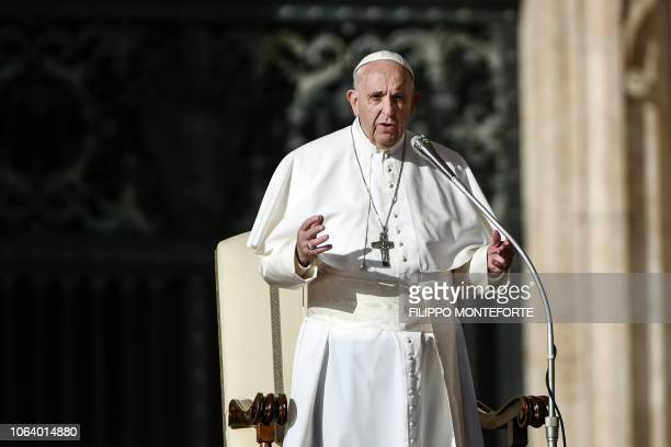 Pope Francis delivers his message to the faithful during the weekly general audience at St Peter's square in the Vatican on November 21 2018