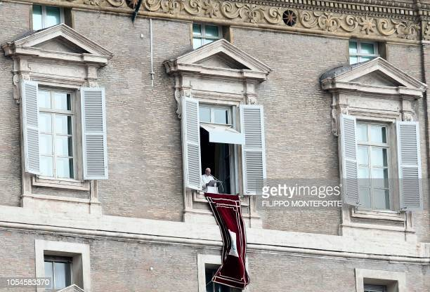 Pope Francis delivers his speech from his studio window overlooking St Peter's Square at The Vatican on October 28 during the Sunday Angelus prayer