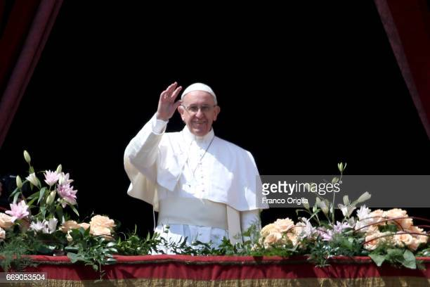 Pope Francis delivers his traditional 'Urbi et Orbi' Blessing to the City of Rome and to the World from the central balcony overlooking St Peter's...