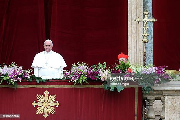 Pope Francis delivers his 'Urbi et Orbi' blessing message from the central balcony of St Peter's Basilica at the end of the Easter Mass on April 5...