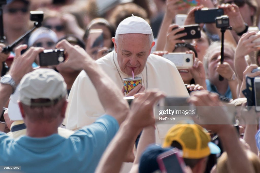 Pope Francis drinks a Mate when his arrives for his weekly general audience in St. Peter's Square at the Vatican, 6 June 2018.