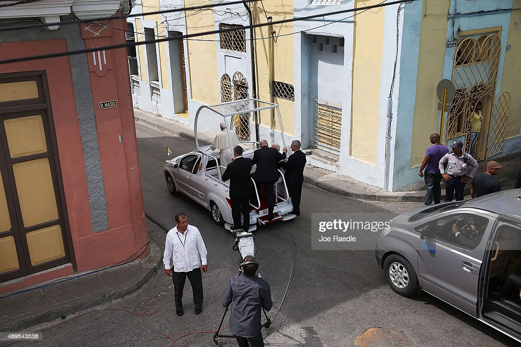 Pope Francis drives away in his Popemobile after leaving the cathedral where he held a mass and blessed the city on September 22, 2015 in Santiago de Cuba, Cuba. Pope Francis leaves for the United States after spending four days in Cuba.