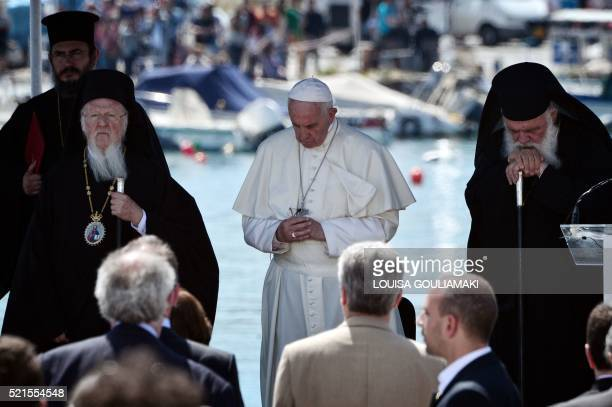 Pope Francis Ecumenical Patriarch Bartholomew and Greece's Archbishop Ieronymos II observe a minute of silence in memory to the victims of migration...