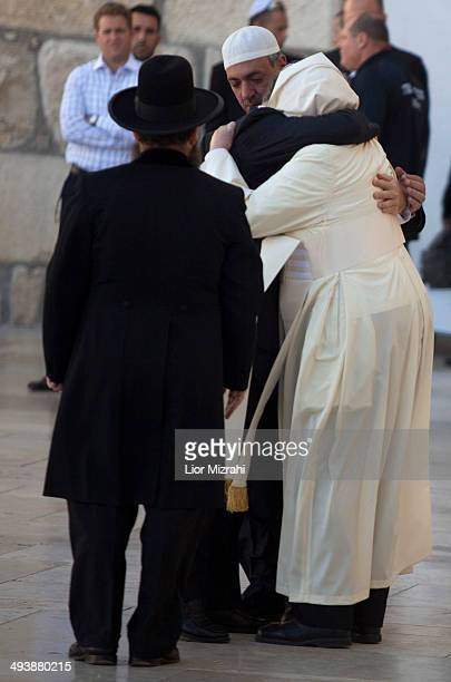 Pope Francis embraces his friends from Argentina Rabbi Abraham Skorka and an unidentified Muslim as the Rabbi of the Western Wall Shmuel Rabinovitz...