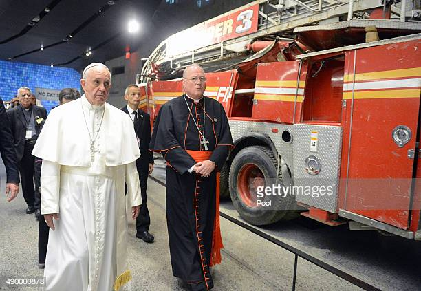 Pope Francis escorted by Cardinal Timothy Dolan as they pass Ladder Company 3 truck visits the 9/11 Memorial Museum in New York City on September 25...
