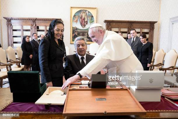 Pope Francis excanges gifts with President of Ecuador Lenin Moreno Garces and his wife Rocio Gonzalez Navas during an audience at the Apostolic...