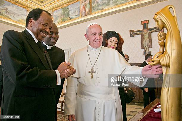 Pope Francis exchanges gifts with Cameroon President Paul Biya and his wife Chantal Biya during an audience at Vatican Apostolic Palace on October 18...