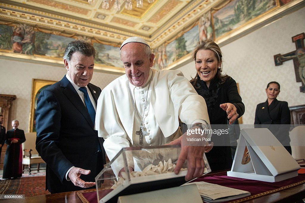 Pope Francis exchanges gifts with Colombia President Juan Manuel Santos Calderon and wife Maria Clemencia Rodriguez de Santos during an audience at the Apostolic Palace on December 16, 2016 in Vatican City, Vatican. Pope Francis is celebrated the 47th anniversary of his priestly ordination on Tuesday 13th December. He will soon mark another milestone, when he turns 80 years old on Saturday 17th December.