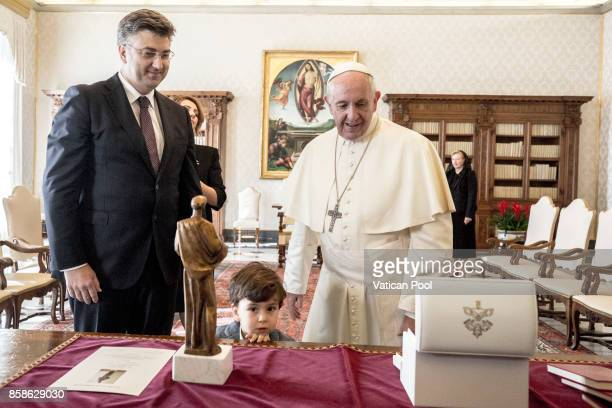 Pope Francis exchanges gifts with Croatia's Prime Minister Andrej Plenkovic and his family during an audience at the Apostolic Palace on October 7...