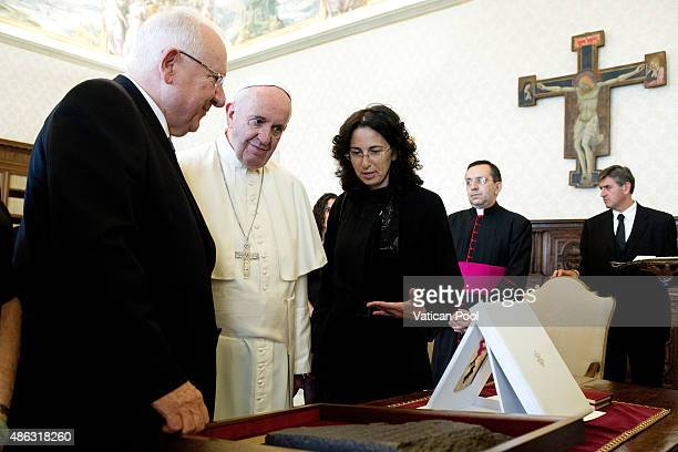 Pope Francis exchanges gifts with Israeli President Reuven Rivlin at his private library in the Apostolic Palace on September 3, 2015 in Vatican...