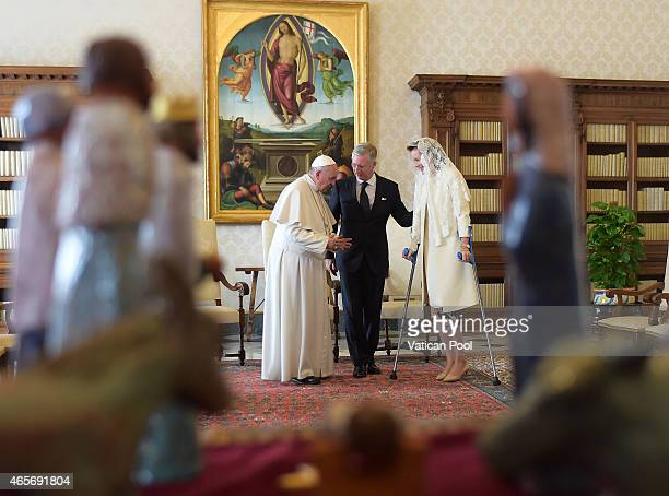 Pope Francis exchanges gifts with King Philippe of Belgium and Queen Mathilde of Belgium at his private library in the Apostolic Palace on March 9...