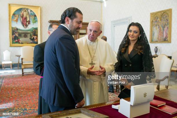 Pope Francis exchanges gifts with Lebanon Prime Minister Saad Hariri and his wife Lara Bashir El Alzem during a private audience at the Apostolic...