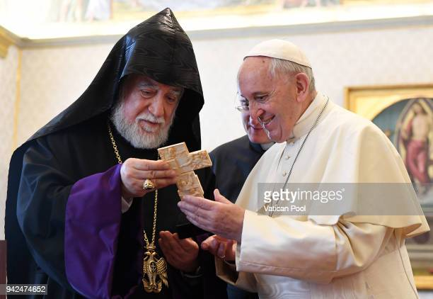 Pope Francis exchanges gifts with Patriarch Aram I at the Apostolic Palace on April 5 2018 in Vatican City Vatican Following the meetings the Pope...
