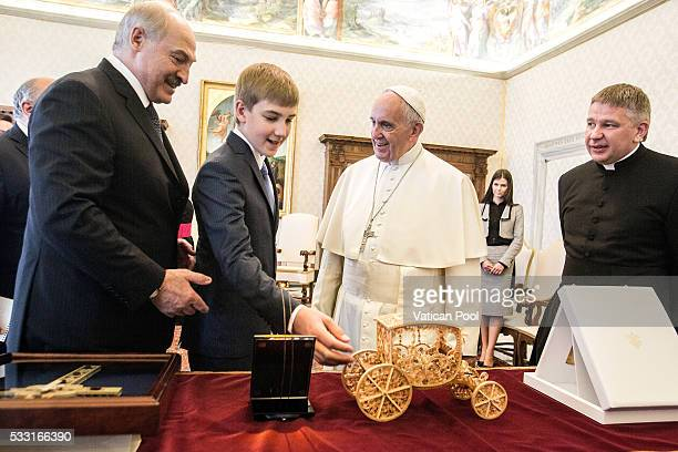 Pope Francis exchanges gifts with President of Belarus Alexander Lukashenko and his son Nikolai Lukashenko during a private audience at the Apostolic...