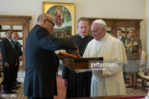 Pope Francis exchanges gifts with President of Fiji Jioji Konousi Konrotea during a private audience at the Apostolic Palace on March 24 2017 in...