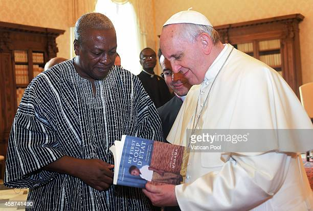Pope Francis exchanges gifts with President of Ghana John Dramani Mahama during an audience at the Apostolic Palace on November 10 2014 in Vatican...