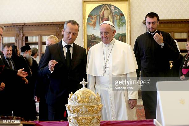 Pope Francis exchanges gifts with President of Macedonia's Parliament Trajko Veljanoski during an audience at the Apostolic Palace on May 16 2016 in...