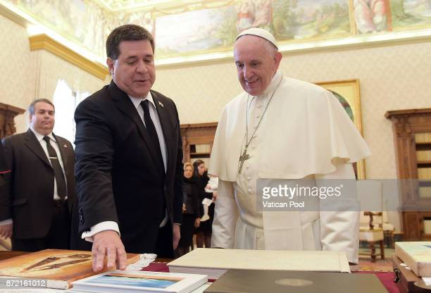 Pope Francis exchanges gifts with President of Paraguay Horacio Manuel Cartes Jara during an audience at the Apostolic Palace on November 9 2017 in...