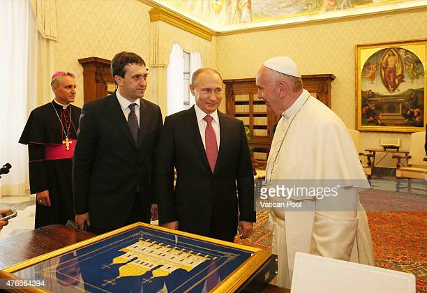 Pope Francis exchanges gifts with President of Russian Federation Vladimir Putin during an audience at the Apostolic Palace on June 10 2015 in...