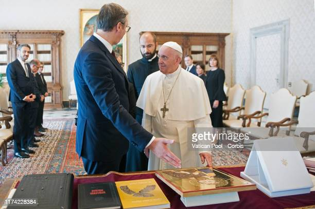 Pope Francis exchanges gifts with President Of Serbia Aleksandar Vucic during a meeting at The Vatican on September 12, 2019 in Vatican City, Vatican.